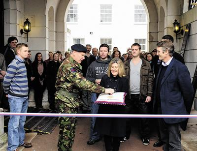 Garrison commander Paddy Tabor hands over the keys to Lorna Owen, PA to Help For Heroes founder Bryn Parry, far right (35502/3)