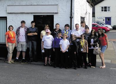 Youth council members and supporters outside the new premises they are buying
