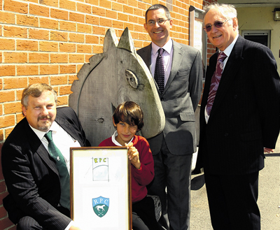 Roundway Parish Council chairman Chris Callow and logo competition winner Miles Parker-Miles, Nursteed Primary School headteacher Tim Heath and Roundway Parish Council vice-chairman Rick Rowland