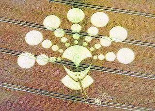 The intricate crop circle of an alien smoking a pipe near the Cherhill white horse