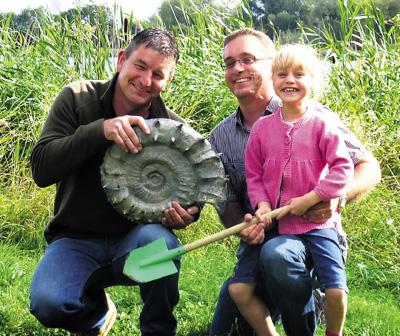 Dr Neville Hollingworth, Jon Baldry and Emily Baldry with the impressive fossil