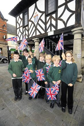 Children from Longleaze Primary School get ready to greet the Princess Royal on Sunday