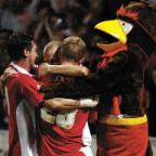 The Wiltshire Gazette and Herald: Jack Smith is mobbed by Lee Peacock, Andy Caton and club mascot Rockin' Robin after levelling the match from the penalty spot last night Ref: 203874-58