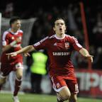 The Wiltshire Gazette and Herald: BREAKTHROUGH: Luke Rooney celebrates his opening goal against Crawley