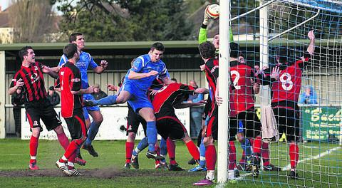 Steve Casey (middle, blue shirt) has brought his spell with Chippenham Town to an end