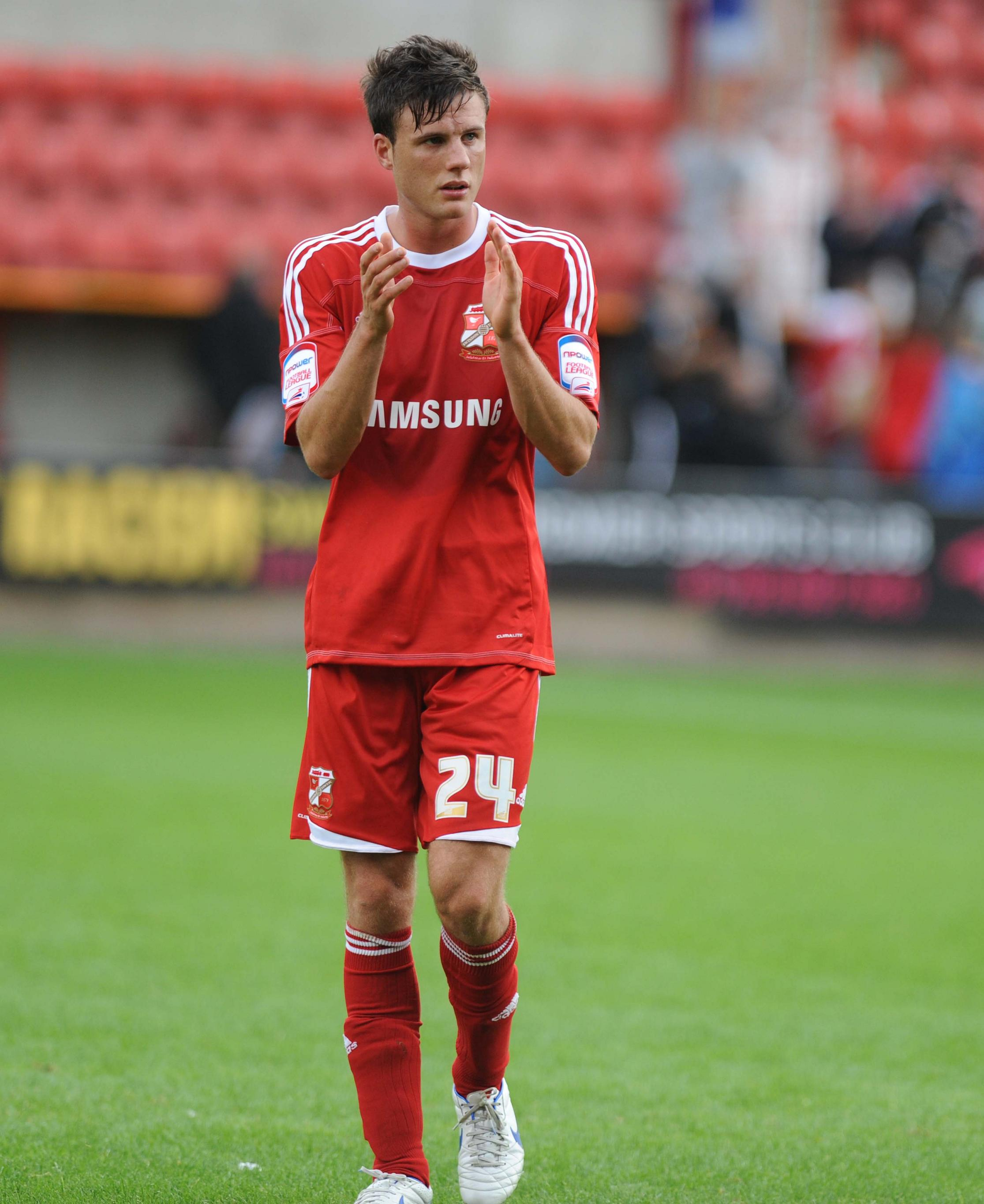 Jonathan Smith was part of the Swindon Town squad that won the League Two title is now at Luton
