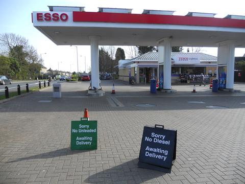 Signs show that the Esso service station in Hungerdown Lane, Chippenham, had run out of fuel today