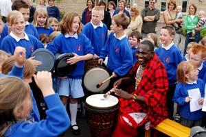 HOT BEATS: Erick Ole Kasana and pupils from Sherston School at the official opening 19430/5