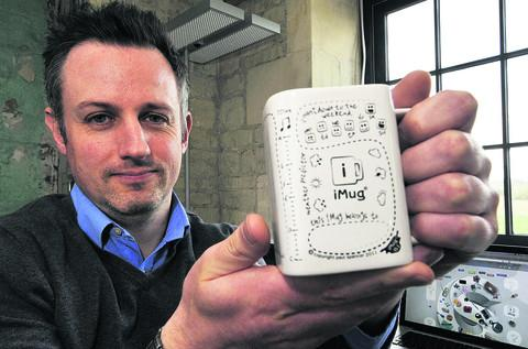 Paul Spencer with his 'iMug', which he hopes will help office workers relieve stress