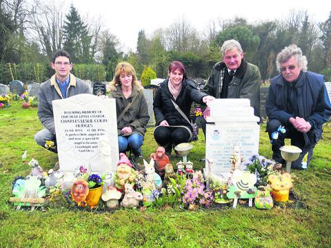 Philip Winchcombe, Julie Barnett, Kylie Mortimer, Charles Winchcombe and Mike Aiston at the children's gravesides