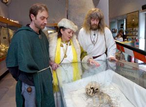 PRAYERS: From left, Druids Paul Davis, Denise Price and Steve Bust with the child's skelton (21955/4)