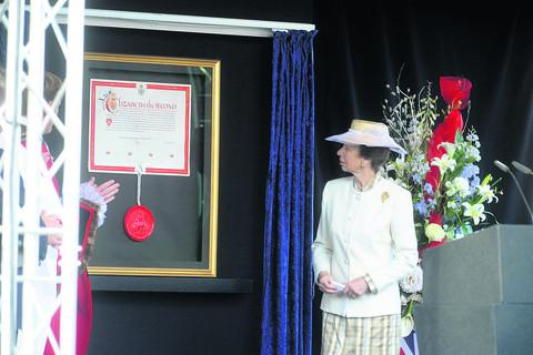 The Princess Royal with the Letters Patent proclaiming Wootton Bassett a Royal town last summer