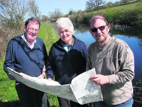 Volunteers John and Pam Harrod and Carsten Drew at the rewatered section of the Wilts & Berks Canal at Dauntsey Lock
