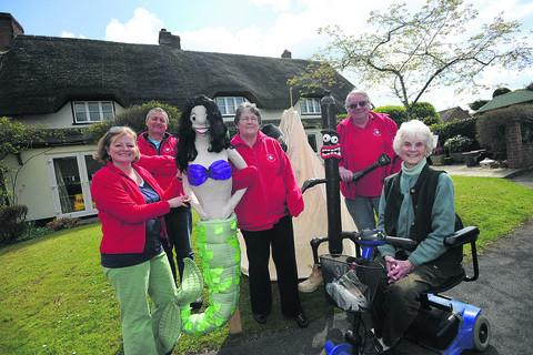 Urchfont Scarecrow Festival committee members, from left, Frances Wood, Rob Pendry, Jean Thomas, Keith Brockie and June Turnbull prepare for the festival with some of last year's creations