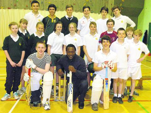 Cricket star Henry Olonga with pupils at Hardenhuish School