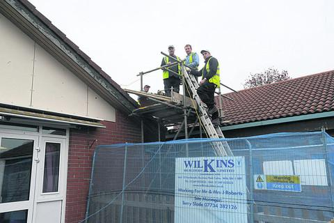 Clive Turk, Paul Green and Daryl Payne of Wilkins Builders of Calne work on the