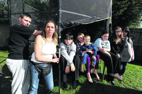 Residents at the Oaks who are annoyed their trampoline will be dismantled. From left, Ashley Wise, Yvonne Archibold, Michael, Megan, Rhys, Bethany, Paris Harland and Carrie Silk.                        (39080) PICTURE BY diane vose