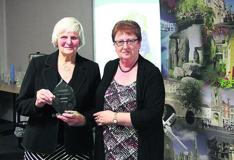 Barbara Stark receives her award from Chippenham Area Board chairman Desna Allen