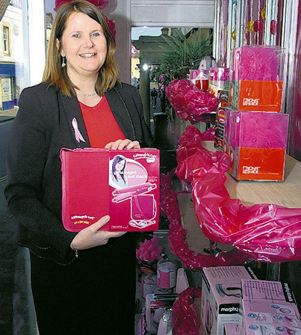 Julie Palmer with her pink display at ES Electrical
