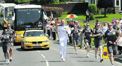 David Hemery carries the Olympic torch