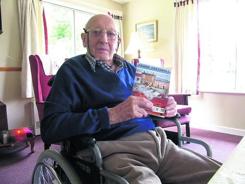 Frank Greenhill with his book One Back From 38, for which he has also designed its cover