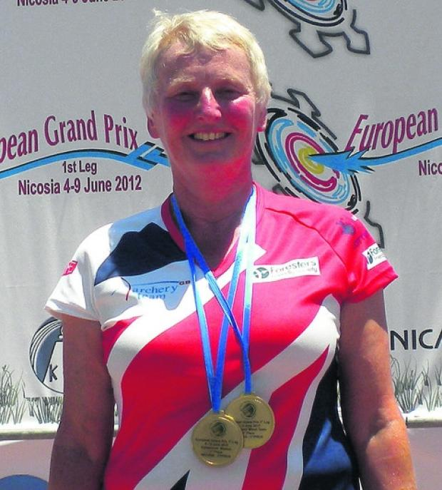 Pauline Burfitt with her two gold medals in Cyprus