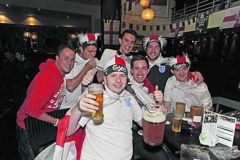 Players from Steeple Ashton Rangers FC, cheering on England in The Albany Palace, Trowbridge on Monday