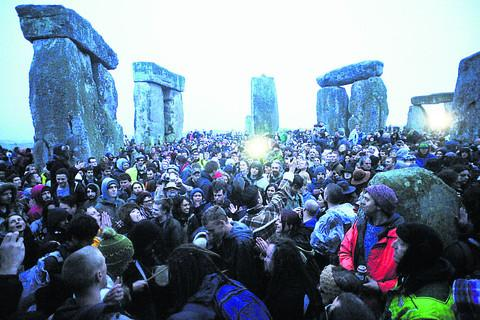 Crowds welcome the summer solstice at Stonehenge this morning