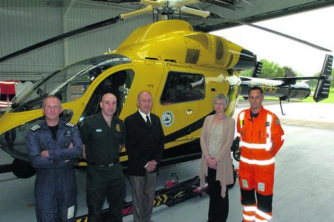 From left, Captain Bob Lewis, paramedic John Gray, Frank and Gillian Daniells and clinical team leader Richard Miller