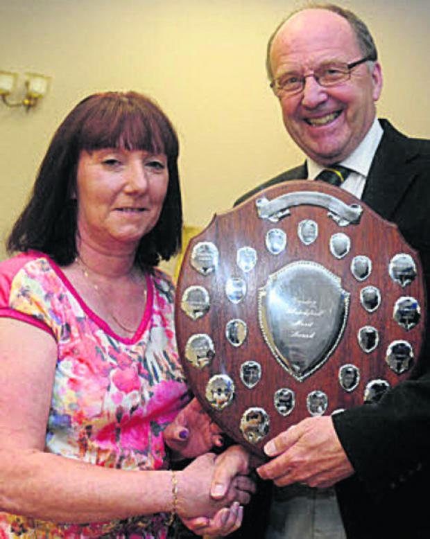 Tina Barnes receives her award from league president Ken Clarke