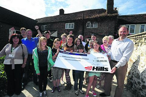 Lou Lou, Jess, Lauren, William and Megan receive the grant from Mike Hill of the Hill's Group