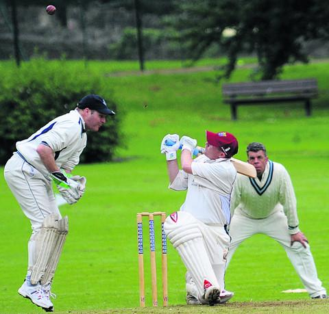 Box wicketkeeper David Kelly just misses a catch as Bradford batsman Ian Pinchen hits out during his side's nine-wicket Division 1 win on Saturday