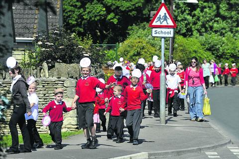 Corsham Regis pupils set off on their giant 'walking bus' to Corsham Court