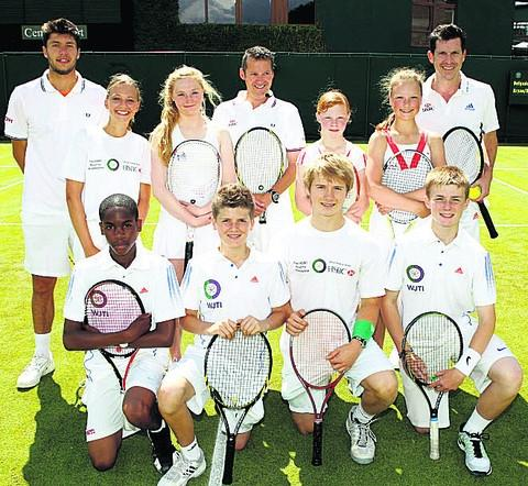 Will Bissett (front, second right) with competitions winners at Wimbledon with Tim Henman (back right) and Oliver Golding (back left)