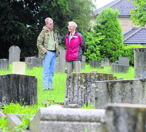 Stephen Fincher, left, visits the grave of his uncle's fiancee Flo at Derry Hill cemetery, with Flo's nephew, Douglas Male