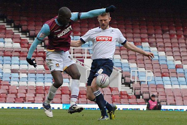 Darren Ward (right) in action against West Ham last season. ROSS EVANS.