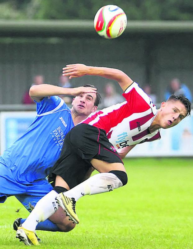 Alex Kite (blue) tries to stop an Exeter attack last night (Picture by Robin Foster)