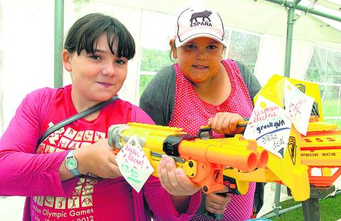Maia Keen and Megan Goddard have fun with water guns