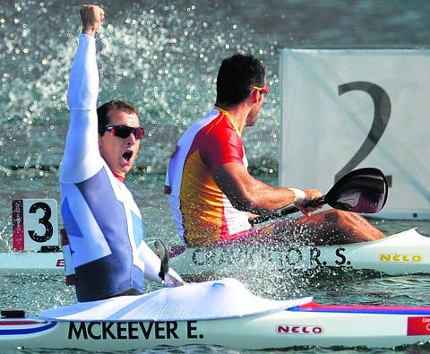 Bradford on Avon hero Ed McKeever celebrates after crossing the line at Dorney Lake