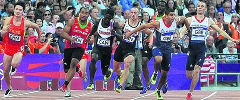 Danny Talbot (far right) makes the ill-fated handover to teammate Adam Gemili during last Friday's 4x100m relay heat in which Great Britain were disqualified