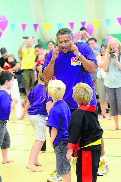 Daley Thompson during his visit to the group