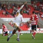 The Wiltshire Gazette and Herald: Nicky Ajose scores the Reds winner