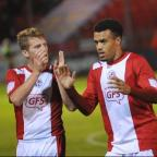 The Wiltshire Gazette and Herald: Goalscorers Nicky Ajose and Billy Clarke celebrate at the end. Picture by Tony Wood