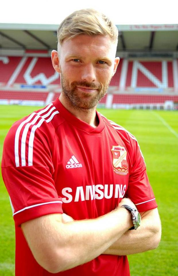 Swindon Town defender Darren Ward