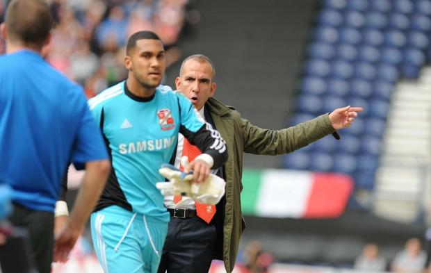 Wes Foderingham and Town boss Paolo Di Canio at Deepdale yesterday