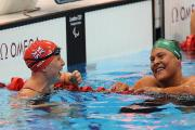 Stephanie Millward (left) is in to her fifth final after qualifying from her SM9 200m individual medley heat behind Natalie du Toit (right)
