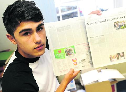 Alex Singh with a copy of the Gazette and Herald