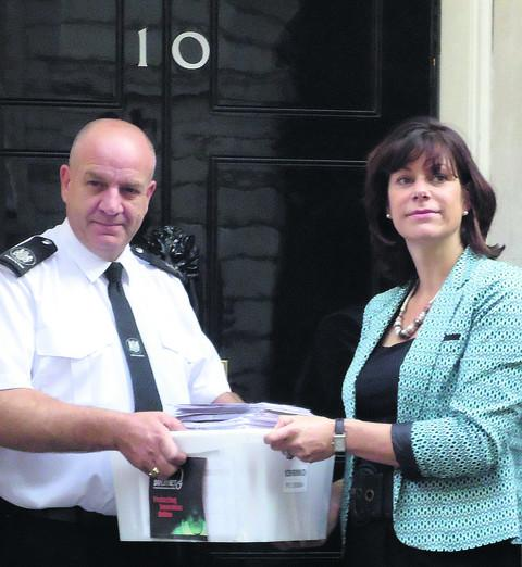 Claire Perry hands the online safety petition in at No. 10 Downing Street
