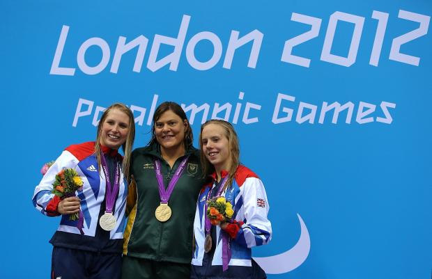 Stephanie Millward (left) with 200m individual medley winner Natalie Du Toit and bronze medallist Louise Watkin