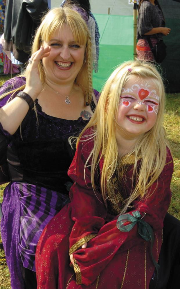 Fair-goers enjoy the medieval merriment